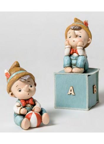 Salvadanaio Pinocchio 2 modelli assortiti + sacchetto 130575-A Pinocchio Ad Emozioni